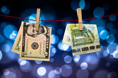 Money clipping on twin Royalty Free Stock Images