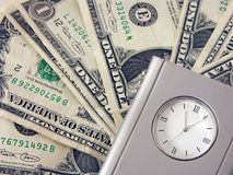 Money and clock Stock Photos