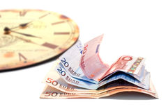 Money and clock Stock Images