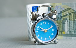 Money and clock Royalty Free Stock Image
