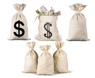 Close-up of Money in bags isolated on white. Money close-up bag bags isolated on white white objects Stock Photo