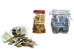 Money in closed glass jars- Donation. Royalty Free Stock Images