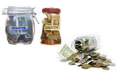 Money in closed glass jars- Donation. Royalty Free Stock Photo