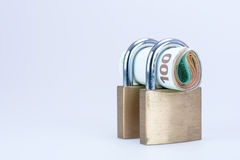 Money in closed padlock Royalty Free Stock Image