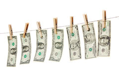 Money on clothes line isolated Stock Photo