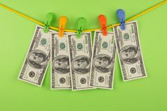 Money on clothespins Stock Photography