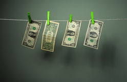 Money on clothespins, green background Royalty Free Stock Photos