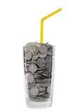 Money cocktail. Glass with chinks and yellow straw on a white background. Money cocktail Stock Images