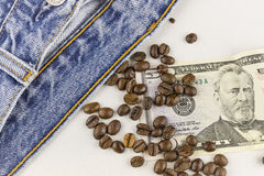 Money,coffee beans and jeans. Money,coffee beans and blue jeans Royalty Free Stock Photo