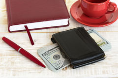 Money and coffee on the table Royalty Free Stock Photo