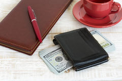 Money and coffee on the table Stock Images