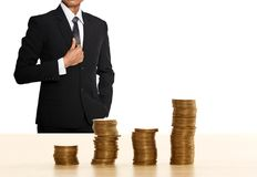Money coin stack with business man royalty free stock image