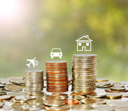 Money coin stack growing graph with icon travel car and house. Finance and save money concept, Money coin stack growing graph with icon travel car and house on Royalty Free Stock Photos