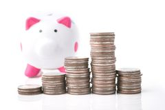 Money coin stack with piggy bank Stock Photo