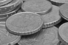 Money coins background. Euro coins with patina. Selective focus. Close-up Black and white image Black and white image stock photography