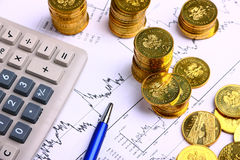 Money coins, calculator Stock Photos