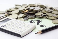 Money coins, calculator and some stationery on white background, top view - financial background concept stock photo