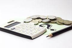 Money coins, calculator and some stationery on white background, top view - financial background concept stock photos