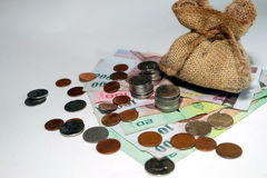 Money coins came out from brown money bag Royalty Free Stock Images