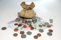 Money coins came out from brown money bag Stock Image