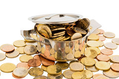 Money coins. A cooking pot is filled with euro coins, symbolic photo for funding Stock Image
