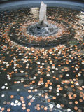 Money (coins) in the fountain Royalty Free Stock Photos