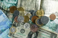 Money coins and notes different countries with a lot of texture stock photography