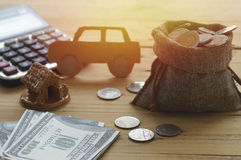 Money coins and pape. R with house, concept in insurance,loan,finance and buying car background Royalty Free Stock Image