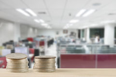 Money coins pile with abstract blur office background Royalty Free Stock Photos