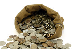 Money coins pour out from bag Royalty Free Stock Images