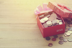 Money coins in present and gift box Stock Photo