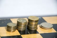 Money, coins sorted into piles stock image
