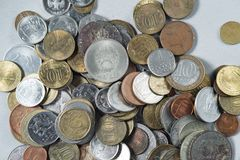 Money coins scattered heap on gray background Stock Images