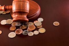 Money. Coins of the world and auction hammer on the table Royalty Free Stock Images