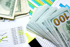 Money with colorful charts and marker. Stock Photo