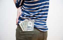 Money comes out from girls pocket Stock Photos