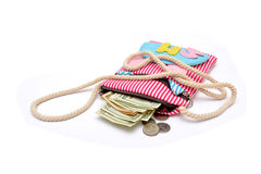 Money coming out of girl hand bag Stock Images
