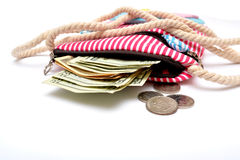Money coming out of girl hand bag close up Royalty Free Stock Photo