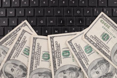Money on Computer Stock Photography