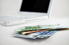 Money on Computer Royalty Free Stock Images