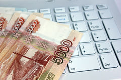 Money for the computer Stock Photography
