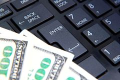 Money on computer keyboard. Background Royalty Free Stock Photo