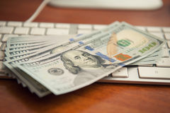 Money on computer keyboard Royalty Free Stock Image