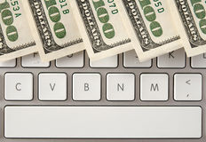 Money on computer keyboard with spacebar Royalty Free Stock Images