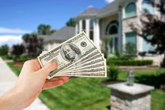 Money concept. With house in background Royalty Free Stock Photo