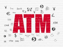 Money concept: ATM on wall background. Money concept: Painted red text ATM on White Brick wall background with  Hand Drawn Finance Icons Royalty Free Stock Images