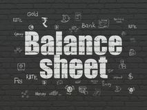 Money concept: Balance Sheet on wall background. Money concept: Painted white text Balance Sheet on Black Brick wall background with  Hand Drawn Finance Icons Stock Photos