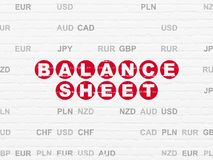 Money concept: Balance Sheet on wall background. Money concept: Painted red text Balance Sheet on White Brick wall background with Currency Royalty Free Stock Photos