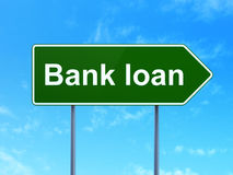 Money concept: Bank Loan on road sign background. Money concept: Bank Loan on green road highway sign, clear blue sky background, 3D rendering Royalty Free Stock Images