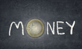 Money concept. Concept image. Word money with fife euro coin instead of letter O stock images
